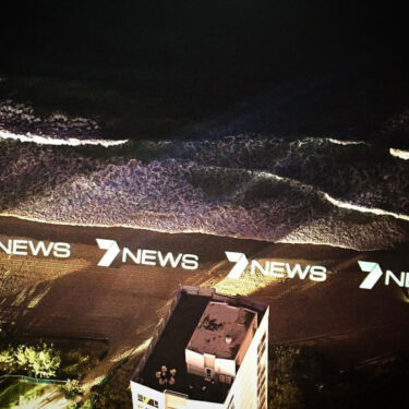 7 news logo projected onto surfers paradise beach from the top of q1 building