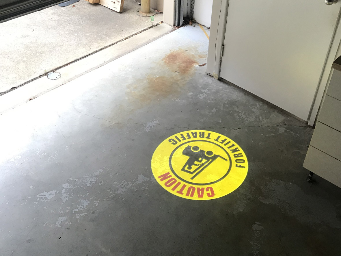 Forklift warning sign projected into factory