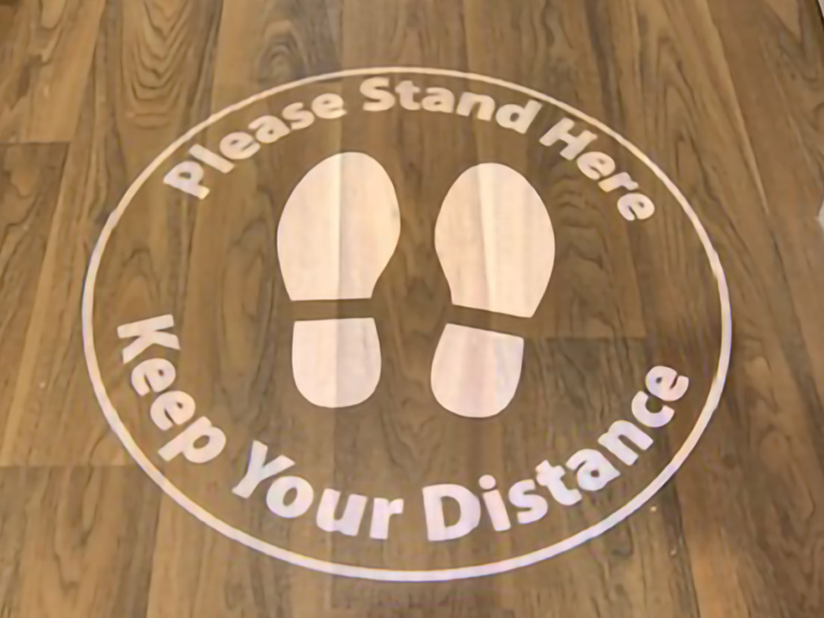 Keep your distance projected sign onto floor