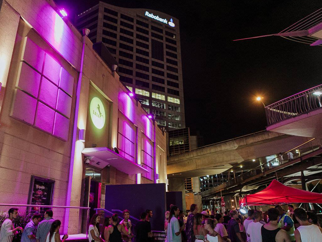SASH projected onto building facade outside home nightclub sydney while patrons wait to enter