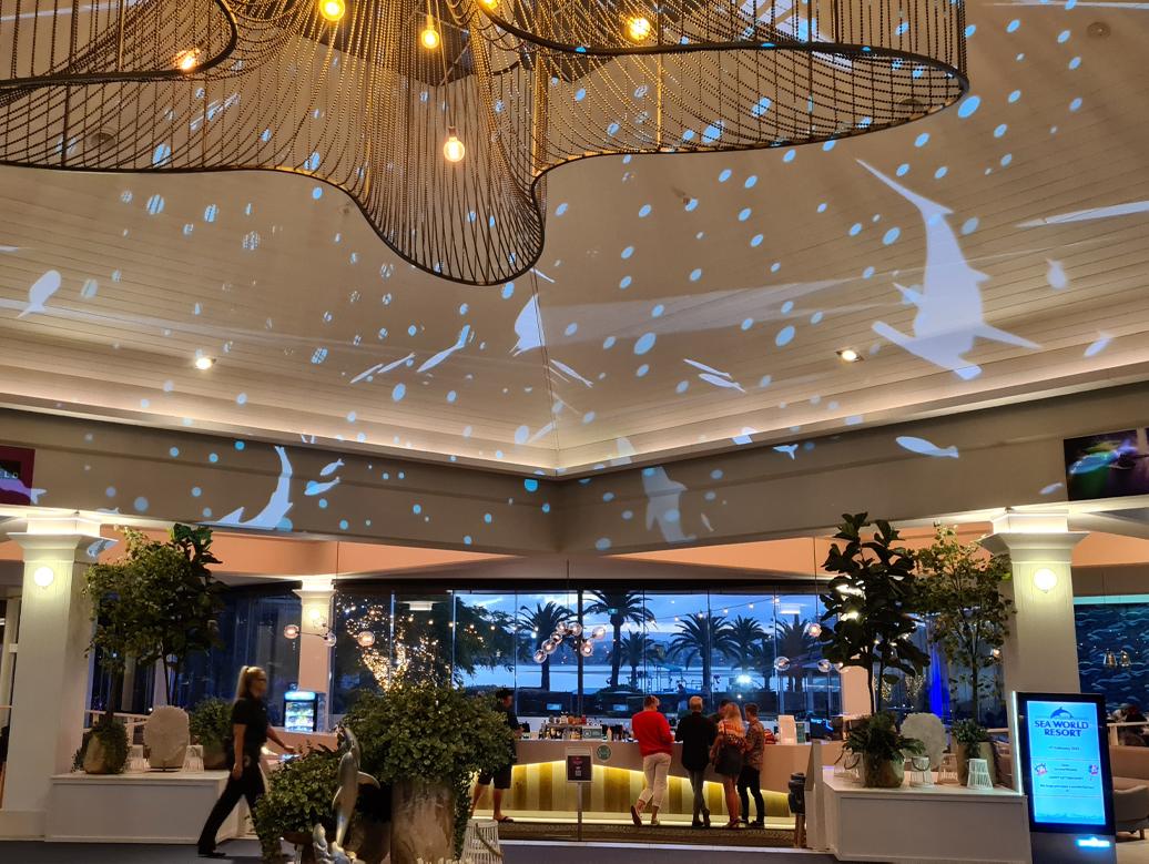 Marine animal projections onto seaworld hotel entrance roof