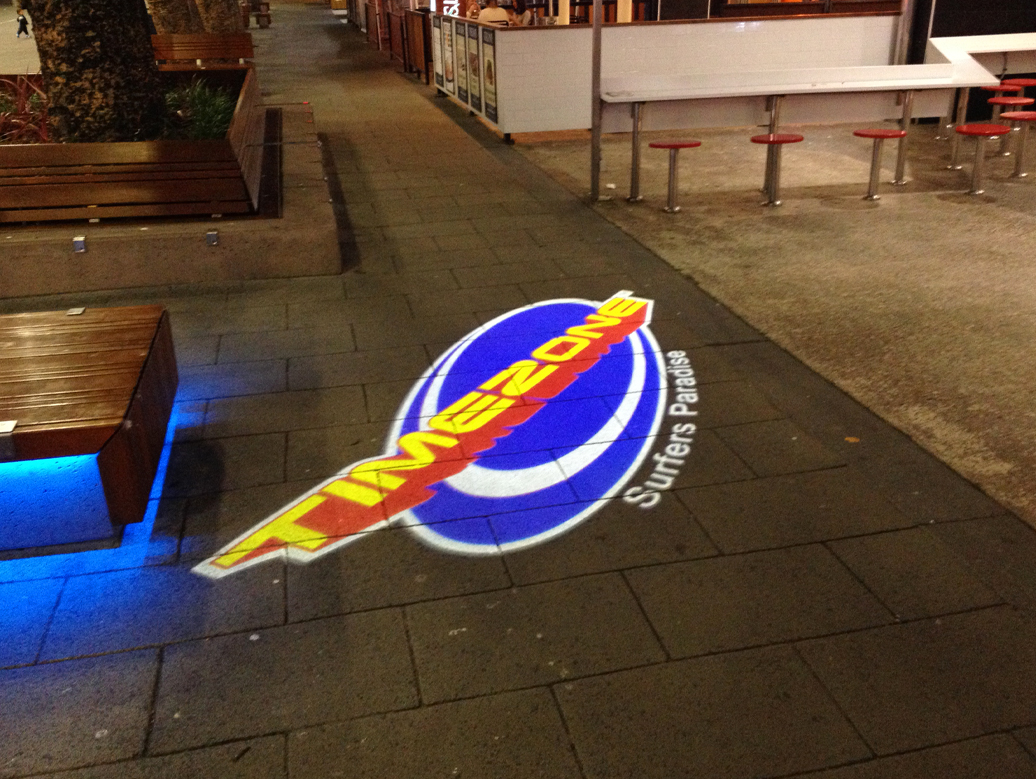Timezone surfers paradise projection onto footpath of cavil avenue