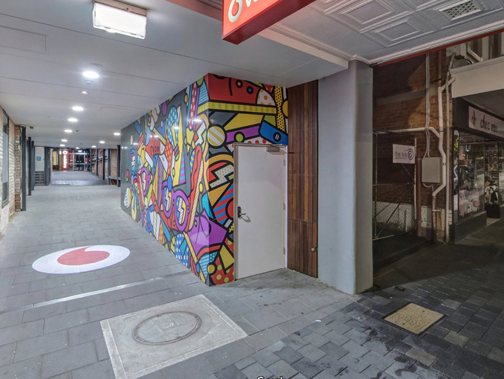 vodafone icon projected onto alleyway footpath