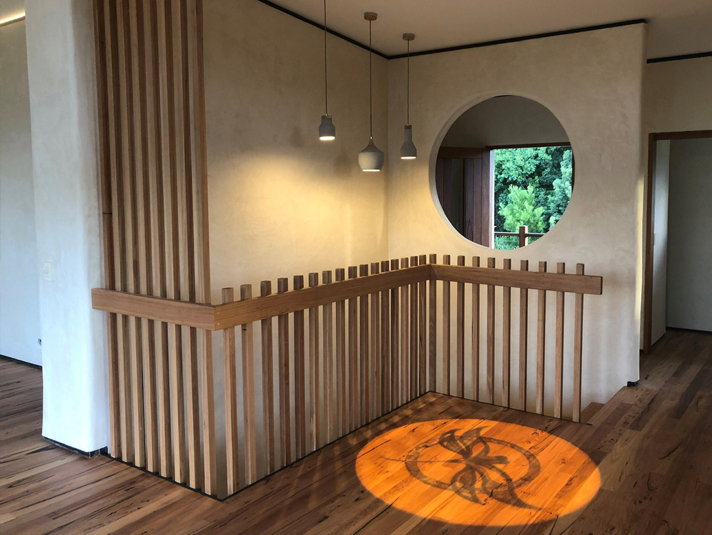dragonfly projection onto timber flooring into house stairwell