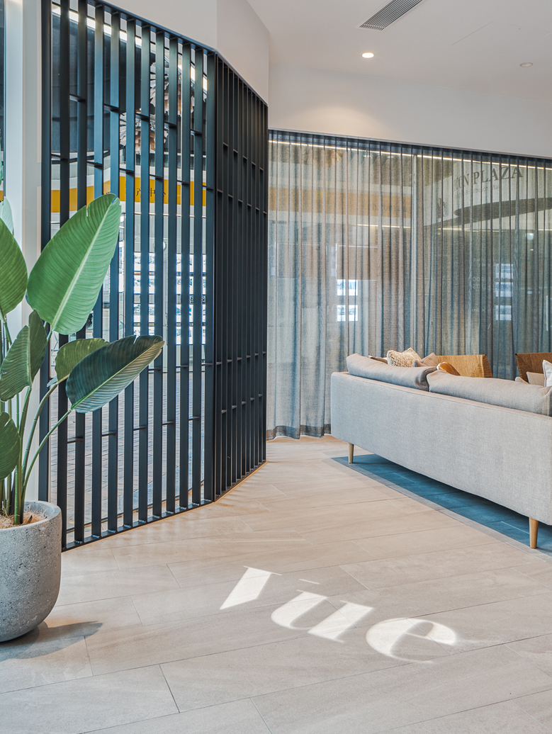 vue projected onto timber flooring in sails office