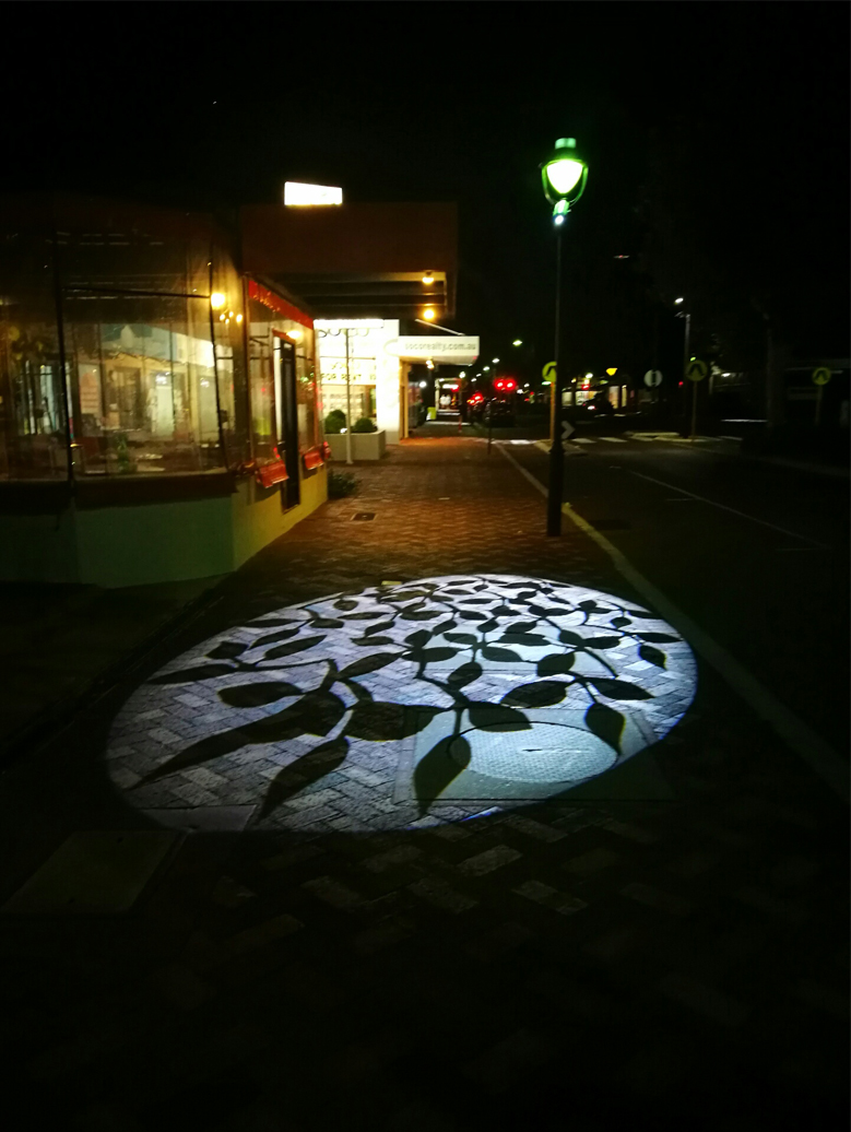 maple leave projection onto footpath