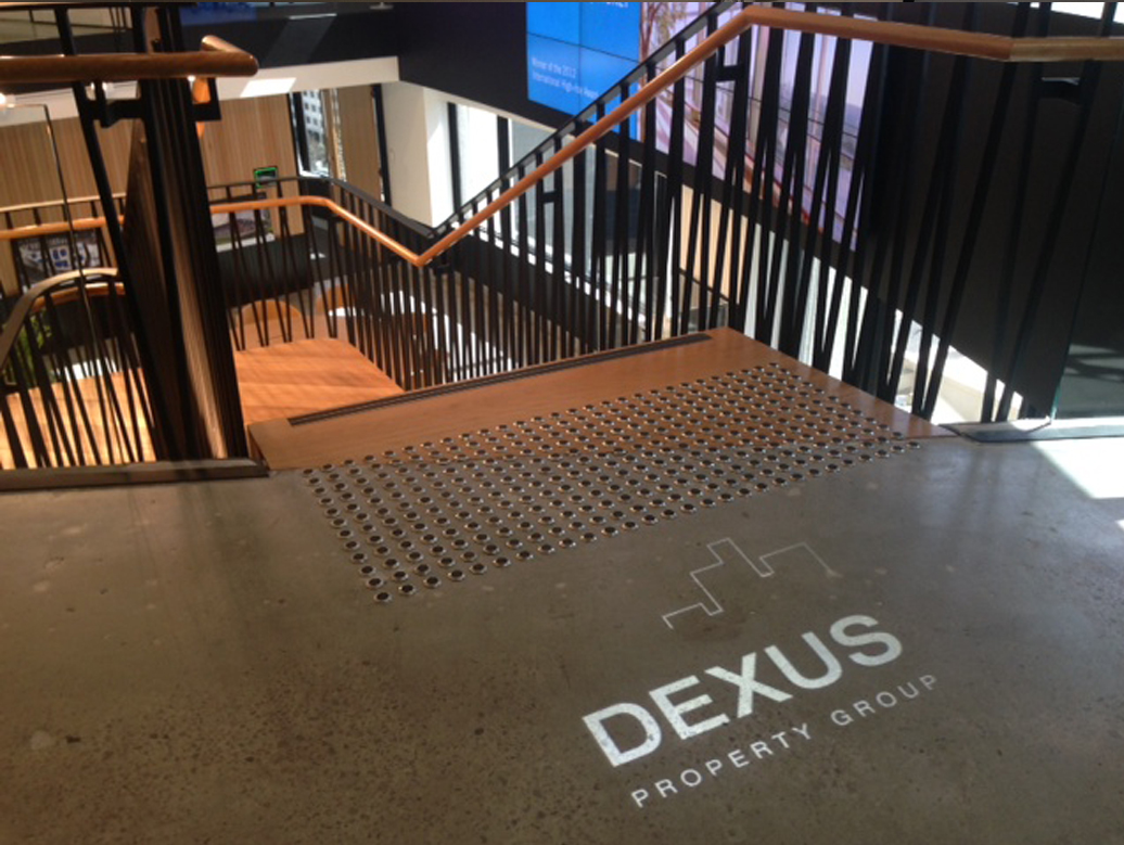 Dexus gobo projection onto top of stairs onto concrete floor