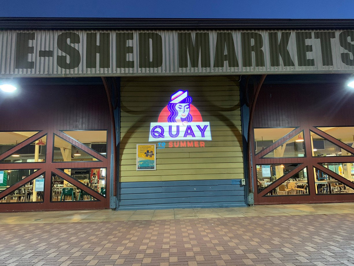 Quay to summer logo projected onto footpath